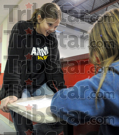 Homework help: Indiana State University student Kali Diethrich helps Deming 5th grade student Carol French with her homework Tuesday night at Ryves Hall.
