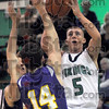 For two: West Vigo's #5, Tyler Wampler shoots and scores during first half action against Vincennes Rivet Tuesday night at the westside school.