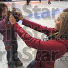 Picture this: Indiana State University student Sara Mays lets Angel use her digital camera to take a photo Tuesday night at Ryves Hall.
