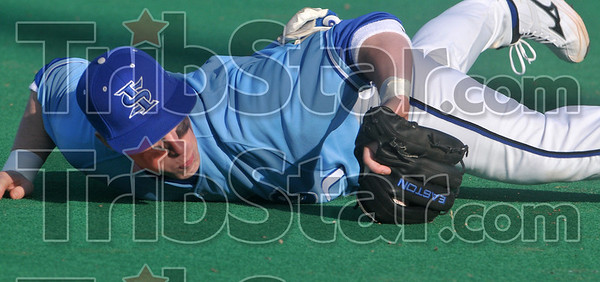 Tribune-Star/Joseph C. Garza<br /> Grounder stop: Indiana State third baseman Luke Fieser dives to stop a St. Louis ground ball during the Sycamores' game against the Billikens Tuesday at Sycamore Field.