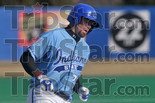Tribune-Star/Joseph C. Garza<br /> Over the top (of the fence): Indiana State's Nick Ciolli rounds third base after hitting a home run during the Sycamores' game against the St. Louis University Billikens Tuesday at Sycamore Field.