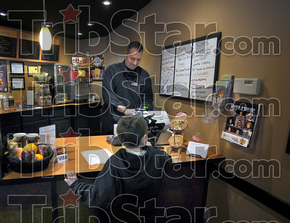 Hot chocolate: Mike McCreary takes an order from a young boy in the Juice Cafe Tuesday afternoon. Wednesday is the last day for the business.