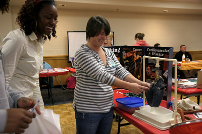 Students participate in a career fair located in Bost Gym