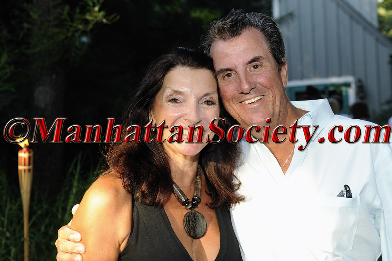 SAG HARBOR-AUGUST 14: Debbie & Kevin McEneaney attend First Pitch Cocktail Party to Celebrate Artists & Writers 61st Anniversary Softball Game at the Home of Debbie & Kevin McEneaney, Sag Harbor, NY (Photo Credit: ©ManhattanSociety.com by Gregory Partanio)