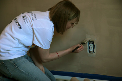 Business Students and volunteers undergo a Habitat for Humanity service project; 2009.