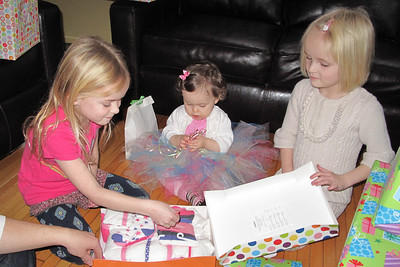 Rosalind and Amelia help open gifts!