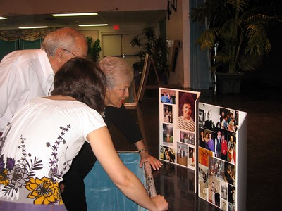 Abby (Bernice's granddaughter) and Herb and Alice (Bernice's friends since childhood) look at photos of Bernice