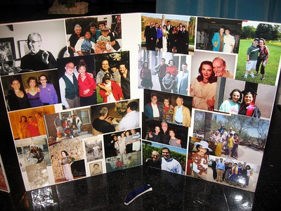 Photo montage of Bernice with family and friends.  In front is a piece of the plate thrown in her honor the night before at Kosta's Greek Eatery, one of her favorite restaurants.