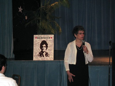 Hope (Bernice's daughter) speaks.  Behind her is the poster that Bernice's friends signed at her birthday party in December 2008.