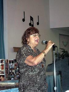 Mary Jo (Bernice's friend) sings You'll Never Walk Alone