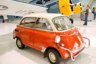 Teeny tiny small car from right on the floor.