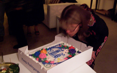 Brenda blows out all the candles