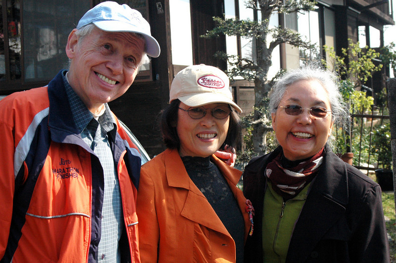 "Jim with Kayoko and Kyoko in front of our place in Moriya in April, 2007 during one of their many visits to Japan. Note the words on the jacket ""Jim MARATHON FINISHER"" - and he didn't get that at the GAP!"