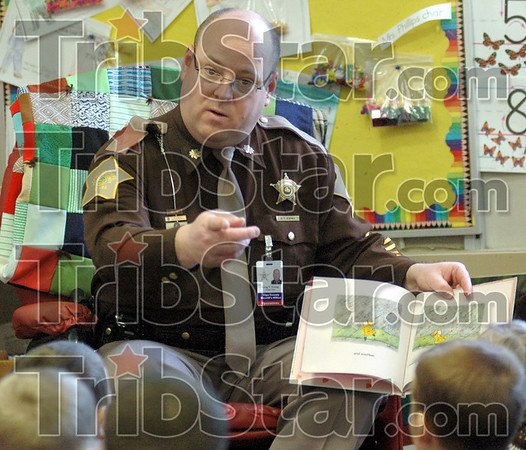 Principal for a day: Vigo Co. Sheriff's department Chief of Operations Greg Ewing acts as principal for a day at Sugar Grove Elementary School Thursday afternoon. Greg's mother was a secretary at the school for many years and he's connected with many teachers there. He's reading a book to a kindergarten class in the photo.