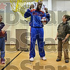"Tribune-Star/Joseph C. Garza<br /> Muggin' mug shots: Harlem Globetrotter Herbert ""Moo Moo"" Evans shows off two autographed photos of himself before presenting them to Rio Grande Elementary School students Seth Bayless, right, and Kelland Sloan Thursday at the school. At left, are fellow Rio Grande students Isabella Fox and Shelby Calloway."