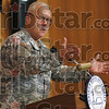 It's all yours: Major General Umbarger gives possession of the Armory to Indiana State University during a ceremony Thursday morning. `