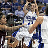 Runner: Indiana State's #33, Kelsey Luna throws up a runner during first half action against Southern Illinois Thursday night at Hulman Center.