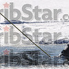 Tribune-Star/Joseph C. Garza<br /> Icy dive: An Indiana Conservation Officer begins his dive while attached to a line at Fowler Park Thursday.