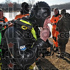Tribune-Star/Joseph C. Garza<br /> Skin tight to keep warm: Indiana Conservation Officer Ryan Jahn of Lawrence County pulls his diving hood over his face as he prepares to dive into the water at Fowler Park Thursday.