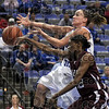 No call: Kara Schilli gets stripped as she goes up for a shot during game action against Southern Illinois Thursday night at Hulman Center.