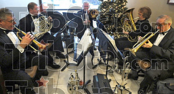 The band played on: Visitors to the Candlewood Suites enjoyed the sounds of brass during Friday night's opening event.