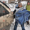 Tribune-Star/Joseph C. Garza<br /> Warm donations: Charlene Loudermilk, a Catholic Charities case manager, carries donated blankets to her car with help from Sandy Waldridge, director of community outreach with the Children's Bureau, and Indiana State social work student, Robbin Holmes, Thursday at the Mix 100.7 radio offices. The blankets were for the homeless that they met while doing the homeless count Thursday.