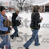 Tribune-Star/Joseph C. Garza<br /> Hitting the snowy pavement: Sandy Waldridge, director of community partners with the Children's Bureau, Charlene Loudermilk, a case manager with Catholic Charities, and Reba Luken with the Children's Bureau, walk down north 15th Street to interview any homeless people they can find for a homeless count Thursday.
