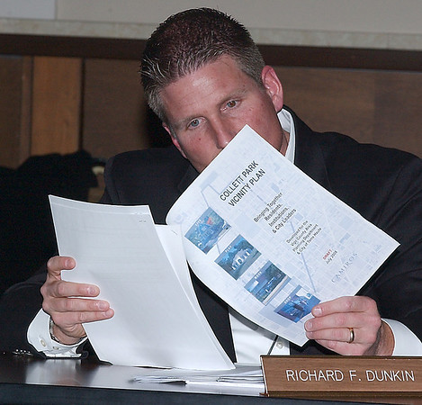 Overseer: Terre Haute city councilamn Rich Dunkin looks over a copy of the Collett Park vicinity plan prior to the Thursday night council sunshine meeting.