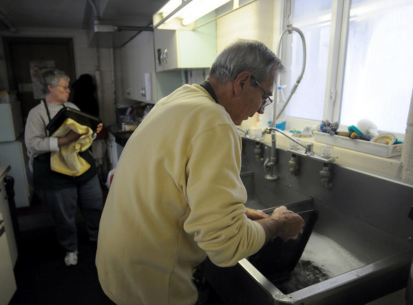 Dishwasher: St. Pat's soup kitchen volunteers Ruth Myers and Ken Gardner do some clean-up after serving lunch Thursday afternoon.