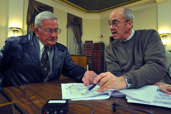 Open for discussion: Terre Haute City Council members Turk Roman and Don Morris talk over the Collett Park Vicinity plan presented to them Thursday evening.