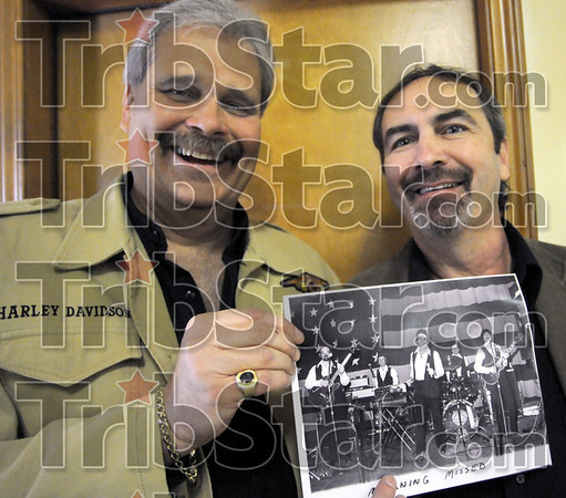 Hall of Fame: Brad Anderson and Randy Rockwell hold a photograph dated about 1976 when the two played in a band called Mourning Missed. They were both inducted into the Wabash Valley Musician's Hall of Fame Sunday afternoon. Anderson was the lead singer of the group and Rockwell is at far right in the photo playing lead guitar.