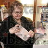 Tribune-Star/Joseph C. Garza<br /> Hand made: Dana Street folds a baby's burp towel after she finished sewing it together Friday in her home's workshop in Hymera. Street is concerned a new federal consumer product law will put her out of business.