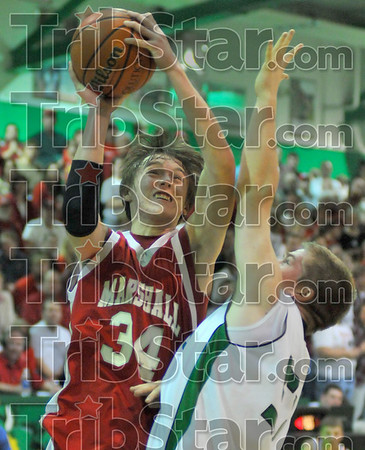 He shoots: Lion Dustin Morey shots over the defense of West Vigo's Joel Modesitt.