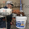 Tribune-Star/Joseph C. Garza<br /> More than a drop in the bucket: Pat Engelland places her donation to the United Way into a bucket Friday at Baesler's. The bucket was lowered down from the roof of the supermarket by United Way Executive Director Troy Fears.