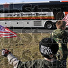 A patriotic sendoff: Alex Stadler, 7, of Staunton and Jeremy Funk, 10, of Terre Haute wave flags as a bus carrying soldiers from the 138th Quartermaster Support Company leaves North Clay Middle School Friday in Brazil. Stadler and Funk are the son and stepson, respectively, of Specialist Helen Marie Corne of the unit.