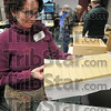Tribune-Star/Joseph C. Garza<br /> Home materials: Indiana Beekeeping School volunteer Cynthia Gaver shows the material used for the frames in the brood boxes that bees will build honeycomb on Saturday during the class in the Ivy Tech building in the Vigo County Industrial Park.