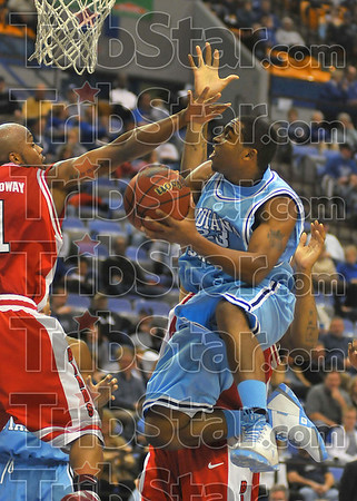 Suspending reality: ISU's Harry Marshall double pumps and puts up a shot against Illinois State's Emmanuel Holloway.