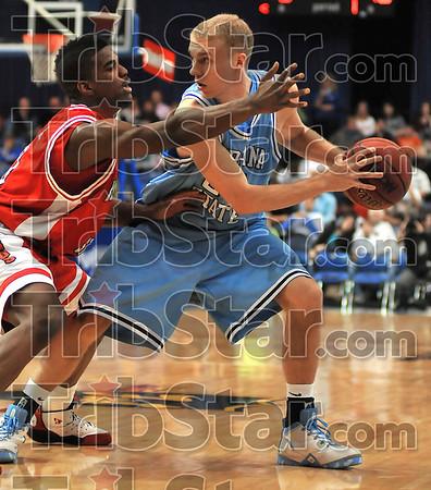 High pressure: Illinois State's Osiris Eldridge plays close defense on Jordan Printy.