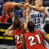Tribune-Star/Joseph C. Garza<br /> No look delivery: Indiana State's Deja Mattox dishes the ball to a teammate off of a drive to the basket over Illinois State's Katie Broadway and Kenyatta Shelton Saturday at Hulman Center.