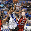 Tribune-Star/Joseph C. Garza<br /> Through traffic: Indiana State's Bianca Jarrett drives to the basket through the Illinois State defense Saturday during the Sycamores' 72-65 win Saturday at Hulman Center.
