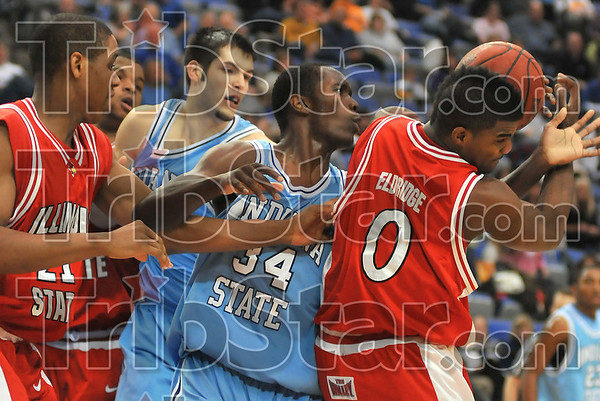 In the thick of things: Sycamore Carl Richard(34) fights for control of the ball with Illinois State's Kellen Thornton(21) and Osiris Eldridge(0). In the back is Indiana State's Jay Tunnell.
