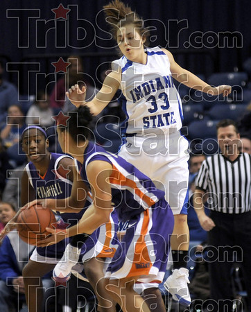 Defending: Indiana State's #33, Kelsey Luna flies past an Evansville player as she tries to apply defensive pressure from above Saturday afternoon in Hulman Center.