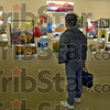 Library art: A patron to the Vigo Co. Public Library stops to look at the photographs displayed in the main branch Thursday afternoon.