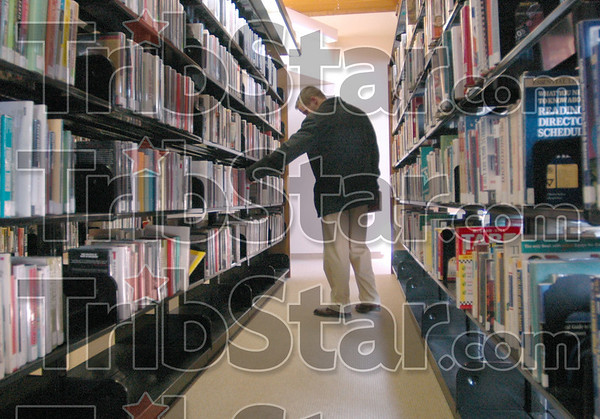 Browsing: Shaun Schoffstall browses the stacks of books at the main branch of the Vigo Co. Public Library Thursday afternoon.