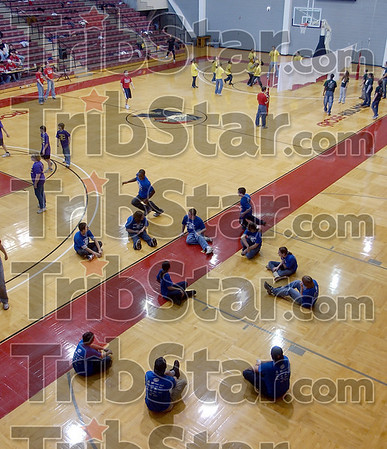 Get together: Vigo County School Corp. middle schoolers play Duck, Duck, Goose in the foreground while others play basketball or blind voleyball in the Rose-Hulman gym Saturday afternoon. The activities were part of a SADD conference.