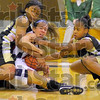SUrrounded: Patriot Danielle Ketner is surrounded by Warren Central's Brandi McKInney and Linzi Moore in second quarter action in the Terre haute North gym Saturday afternoon.