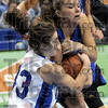 """Tied up: Indiana State's #3, Kelsey Luna gets a """"jump ball"""" call from the officials as she ties-up a Creighton player with the ball. `"""