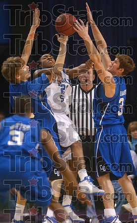 Bluejay jam: Indiana State's Harry Marshall tries to get away a pass in the corner of the court as he is surrounded by Creighton's Kaleb Korver and Casey Harriman during the Sycamores' 79-61 loss Wednesday at Hulman Center.