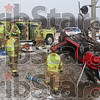 Tribune-Star/Joseph C. Garza<br /> Icy inversion: Honey Creek Fire Department personnel clean up the wreck scene of a single car accident on north bound US 41, north of Harlan Road, Wednesday morning.