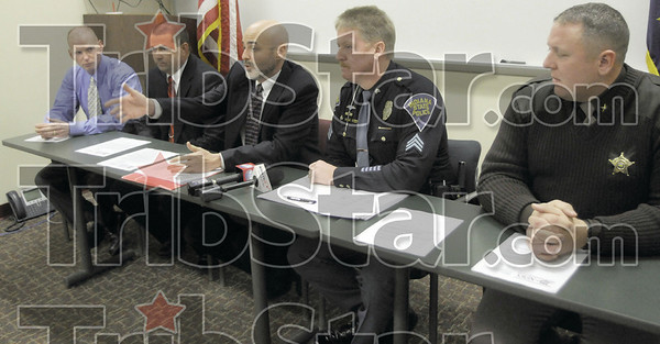 Response: Clay Co. prosecutor Lee Reberger responds to question from the media during a press conference at the Clay Co. jail Wednesday afternoon. At left are Indiana State Police detectives Chris Carter and Sam Stearley, (Reberger), ISP public information officer Sgt. Joe Watts and Clay Co. Sheriff Mike Heaton.
